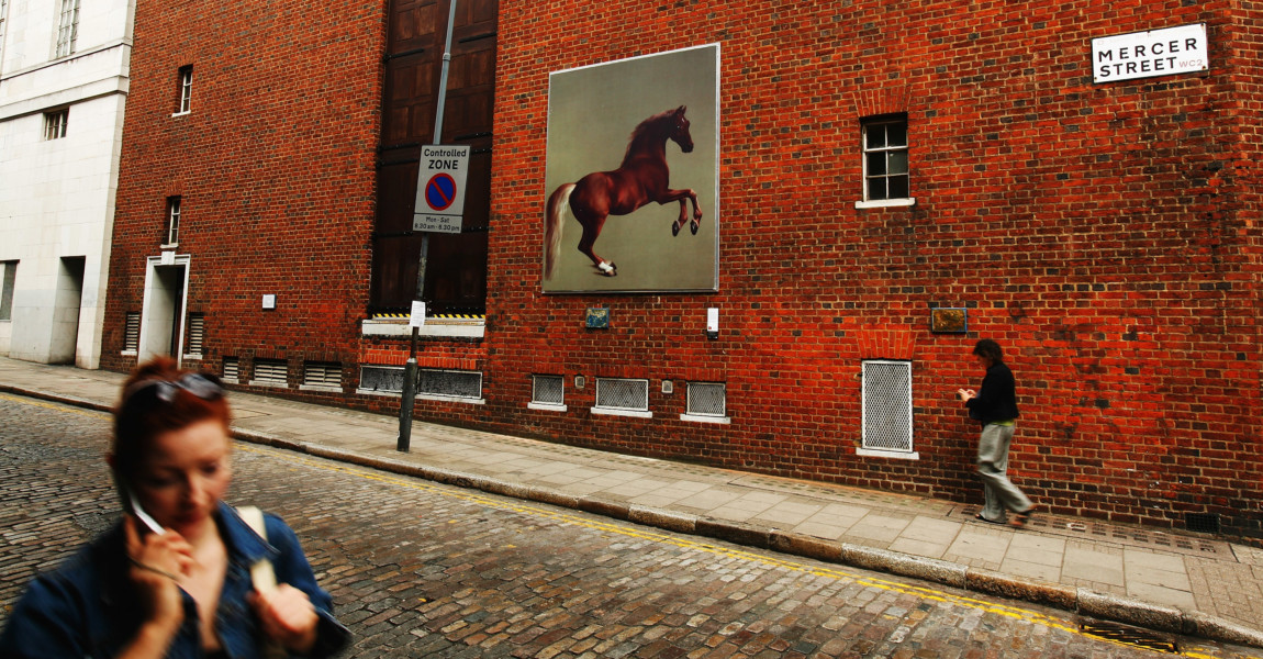 National Gallery Presents Art On London's Streets LONDON - JUNE 12:  Passers by walk past a reproduction of George Stubbs painting, Whistlejacket on June 12, 2007 in London, England. The Grand Tour, is an exhibition on the streets of London's SOHO area, consisting of 30 full sized re-creations of National Gallery Paintings.  (Photo by Daniel Berehulak/Getty Images)