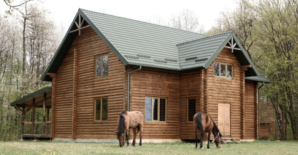 Horses,On,Wooden,House,Background,A,Small,,European-style,Wooden,House Horses on wooden house background